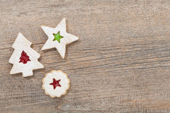 Christmas Cookies. Overhead view of 3 linzer christmas cookies on a wooden background. Copy Space stock image