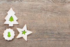 Christmas Cookies. Overhead view of 3 linzer christmas cookies on a wooden background. Copy Space stock photos