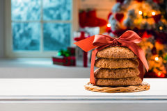 Christmas cookies packed red ribbon on the table Stock Images