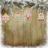 Christmas cookies, pine branches on snowy wooden background. Wooden background with Christmas cookies and pine branches Stock Image