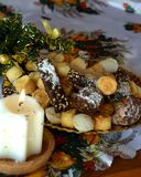 Christmas cookies on a plate decorated on a table and white lighted candle Stock Photography