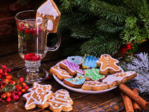 Christmas cookies plate and glass latte mug with berry. Christmas cookies on plate with fir branches. Christmas still life with glass latte mug hot drink with royalty free stock photo