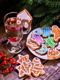 Christmas cookies plate and glass latte mug with berry. Christmas cookies on plate with fir branches. Christmas still life with mug hot drink with red berry on stock photography