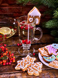 Christmas cookies plate and glass latte mug with berry. Christmas glass latte mug and Christmas multicolored cookies on plate with fir branches. Mag decoration stock photos