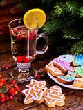 Christmas cookies plate and glass latte mug with lemon. Christmas glass latte mug and Christmas multicolored cookies on plate with fir branches. Mag decoration royalty free stock photo