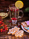 Christmas cookies plate and glass latte mug with lemon. Christmas glass latte mug and Christmas multicolored cookies on plate with fir branches. Mag decoration stock photography