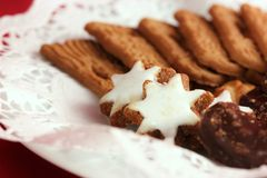 Christmas Cookies. On a plate with tip on a red ground Stock Images