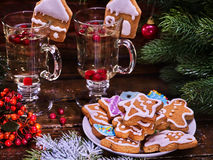 Christmas cookies on plate and two glass latte mug. Cookies on plate with fir branches. still life with pair mug hot drink on wooden table stock image