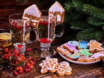 Christmas cookies on plate and two glass latte mug. Cookies on plate with fir branches. still life with pair mug hot drink on wooden table in restaurant stock image