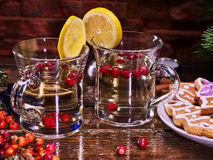 Christmas cookies plate and two glasses mug with red berries. Stock Images