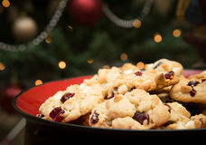 Christmas Cookies. Plated Christmas cookies in front of a Christmas tree Royalty Free Stock Images