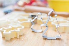 Christmas cookies preparation on wood table Stock Image