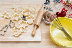 Christmas cookies preparation on wood table Stock Images