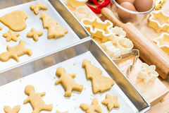 Christmas cookies preparation on wood table Royalty Free Stock Images