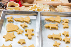 Christmas cookies preparation on wood table Stock Photos