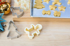 Christmas cookies preparation on wood table Stock Photo