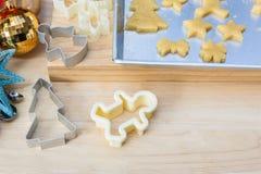 Christmas cookies preparation on wood table Stock Photo