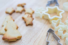 Christmas cookies preparation on wood table Royalty Free Stock Photos