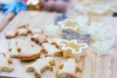 Christmas cookies preparation on wood table Royalty Free Stock Photo