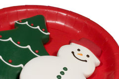 Christmas Cookies on Red. Snowman and Christmas Tree cookies on a red plate. Perfect footer or corner piece for any Christmas design royalty free stock photography