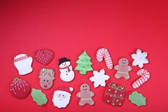 Christmas cookies on red background top view. Various types christmas gingerbread cookies flat lay. Christmas characters cookies. Stock Images