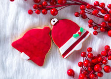 Christmas cookies red bell shape on white fur Stock Photo