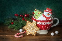 Christmas cookies in the red cup. New year decor Royalty Free Stock Images