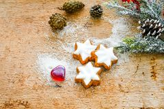 Christmas cookies. And  red  heart on vintage wood background - dark moody  of decorative food, simple composition Stock Photo