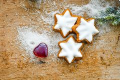 Christmas cookies. And  red   heart on vintage wood background - dark moody image of decorative food, simple composition Royalty Free Stock Images