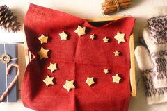 Christmas cookies on the red napkin in the tray  with different accessorizes top view Royalty Free Stock Photos