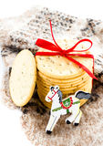 Christmas cookies with red ribbon, horse and knitted mitten Stock Photos
