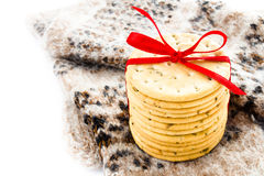 Christmas  cookies with red ribbon and knitted winter mitten iso Royalty Free Stock Photos