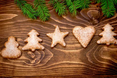 Christmas cookies on rustic wooden table in Christmas night Royalty Free Stock Photos