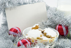 Christmas cookies for Santa. Christmas cookies with red baubles and glass of milk Royalty Free Stock Images