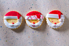 Christmas cookies with santa face on recycled paper Royalty Free Stock Image