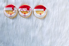 Christmas cookies with santa face on white fur background Royalty Free Stock Photo