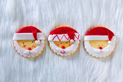 Christmas cookies with santa face on white fur background Royalty Free Stock Image