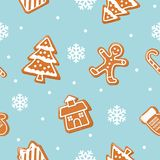 Christmas cookies seamless pattern. Gingerbread man, house, tree, present box on pastel blue background. Vector royalty free illustration