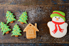 Christmas cookies in the shape of snowman, new year tree and house Royalty Free Stock Photo