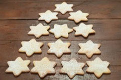 Christmas cookies in the shape of star with flour and butter Royalty Free Stock Photo