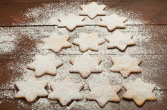 Christmas cookies in the shape of star with flour and butter Stock Images