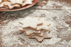 Christmas cookies in the shape of star with flour and butter Royalty Free Stock Photography