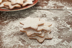 Christmas cookies in the shape of star with flour and butter Royalty Free Stock Images