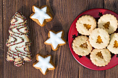 Christmas cookies in a shapes of stars and christmas trees. On natural wooden background Stock Photo