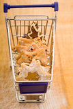 Christmas cookies in shopping cart Royalty Free Stock Image