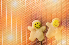 Christmas cookies, shortbread with smiling faces in hot oven.  Royalty Free Stock Images