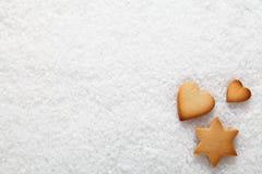 Christmas cookies on snow Royalty Free Stock Photo
