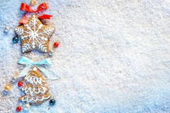 Christmas cookies on snow. Copy space for your text Stock Photos