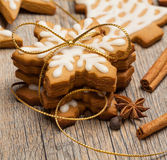 Christmas Cookies. Snowflake shaped Gingerbread cookies stacked and tied with a gold bow royalty free stock photos