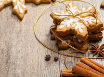 Christmas Cookies. Snowflake shaped Gingerbread cookies stacked and tied with a gold bow stock image